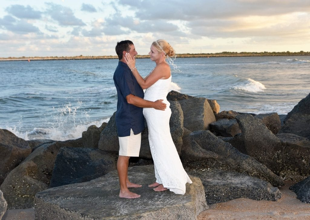Couple saying wedding vows on Vilano Beach at sunset