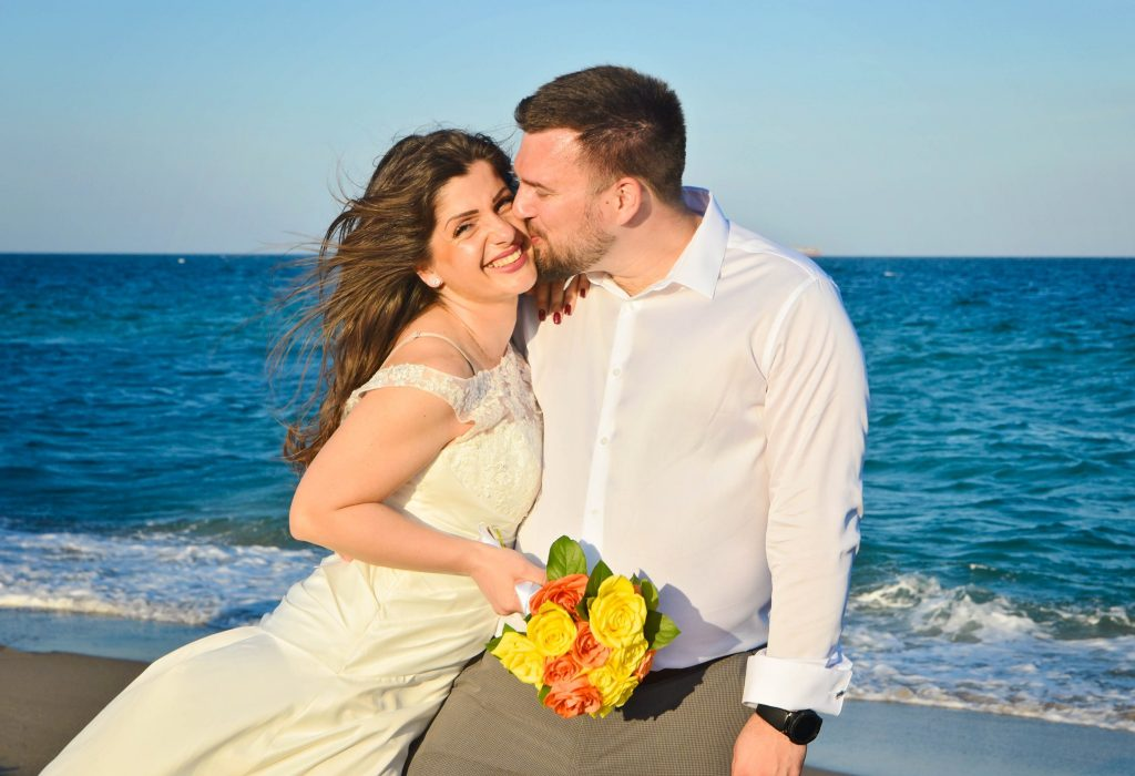 Fort Lauderdale beach wedding couple kisses after marriage ceremony