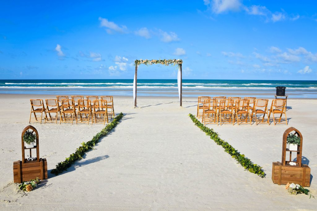 Rustic wedding arch with bamboo chairs on Daytona Beach