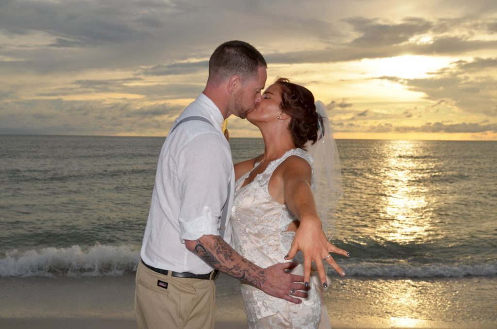 Couple kissing after Gulf beach wedding ceremony on Fort De Soto Beach.