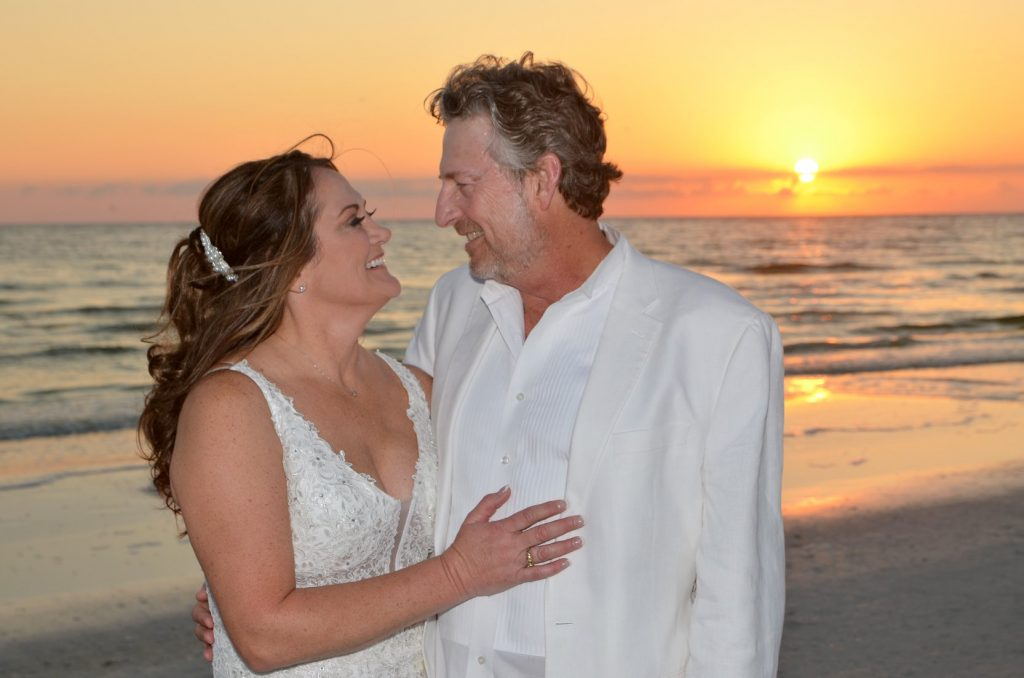 Couple married at sunset beach wedding in Florida