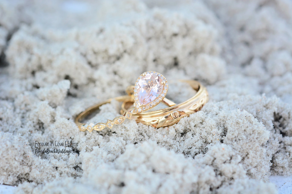 Wedding rings in the beach sand