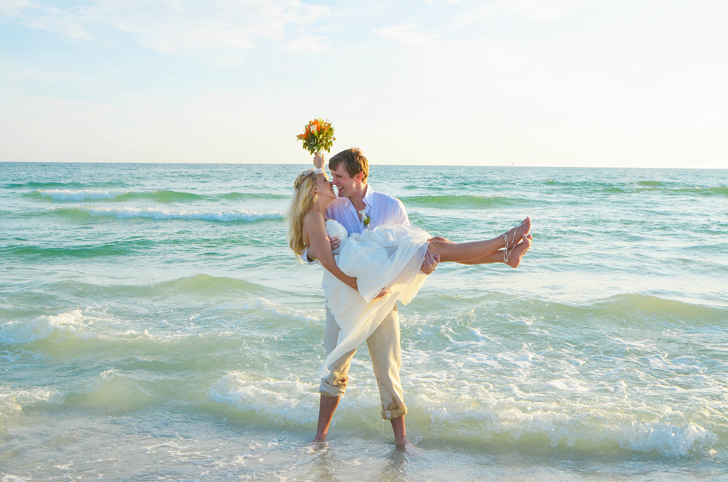 Nokomis beach couple in the surf after beach wedding