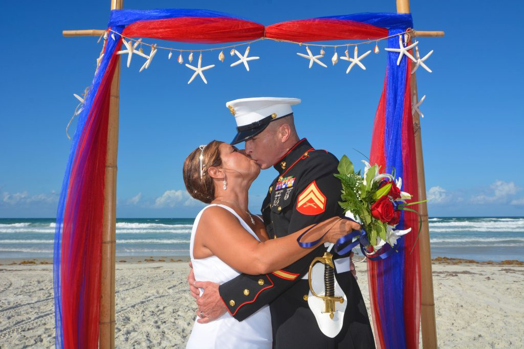 Military groom and bride at beach wedding in Sarasota kissing