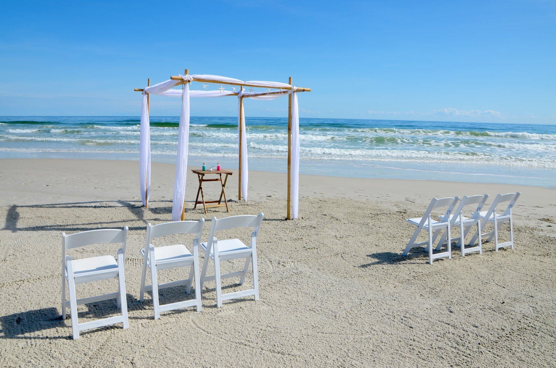 Couple walking down aisle after getting married on Florida Gulf beach