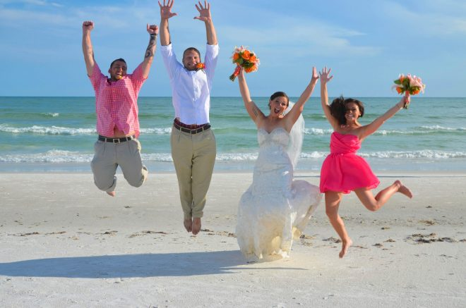 Wedding party jumping on Venice Beach on Gulf coast, Florida