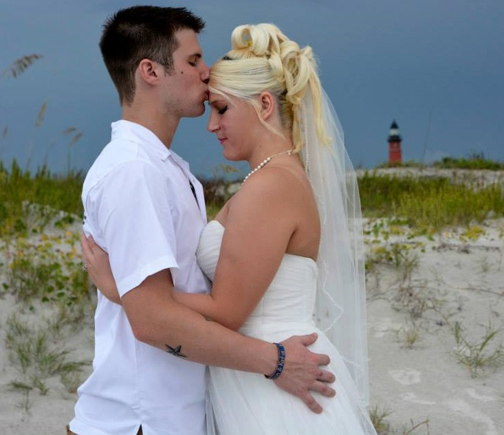 Ponce Inlet bride and groom married on beach with lighthouse in background