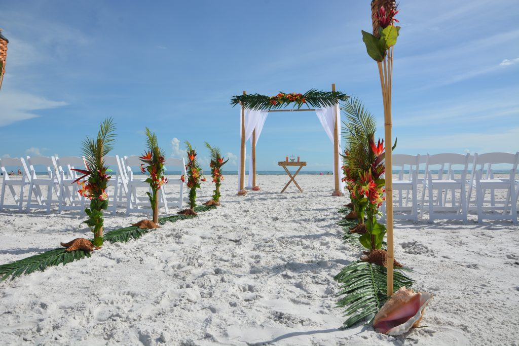 Tropical Distinctive wedding arch on Sand Key Beach, Clearwater, FL
