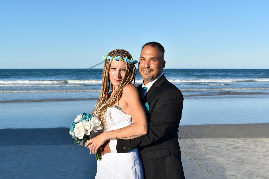 Boho beach bride after wedding in Daytona