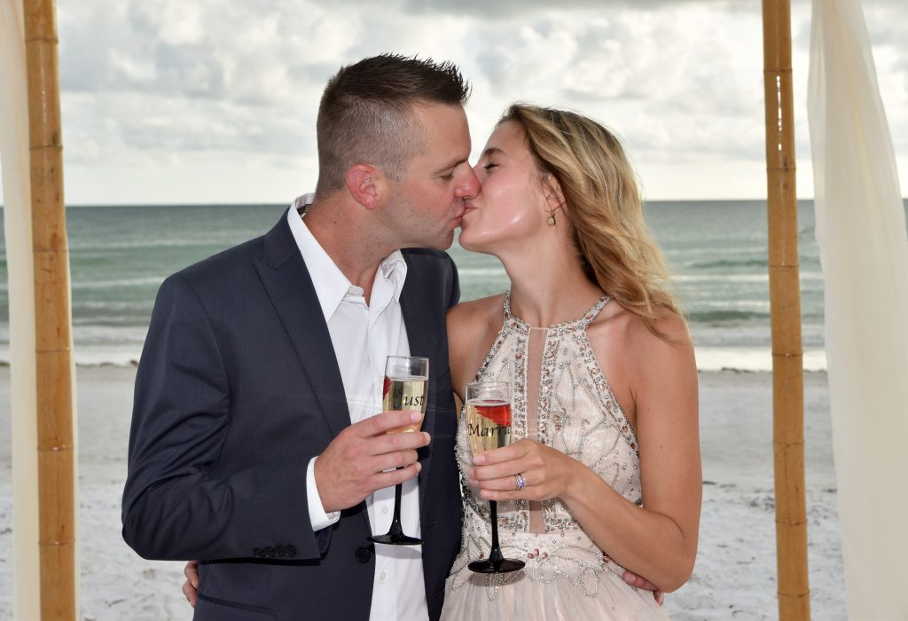 Couple celebrates marriage with toast on Clearwater Beach