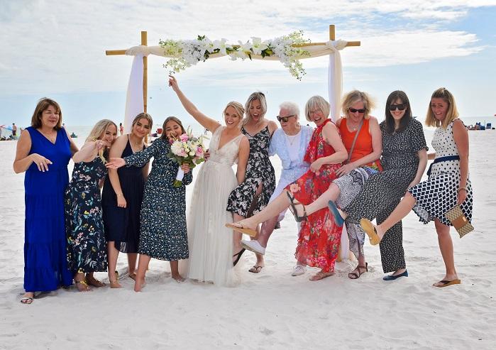 Guests pose with bride at Siesta Key beach wedding