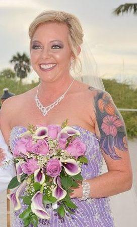 Bride carries lavender lilies at Miami beach wedding