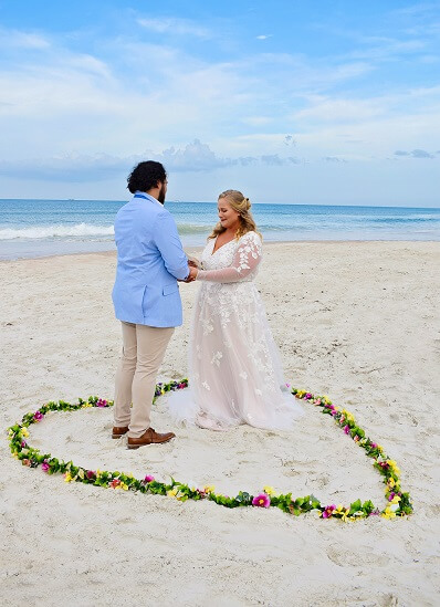 Daytona Couple married heart in sand
