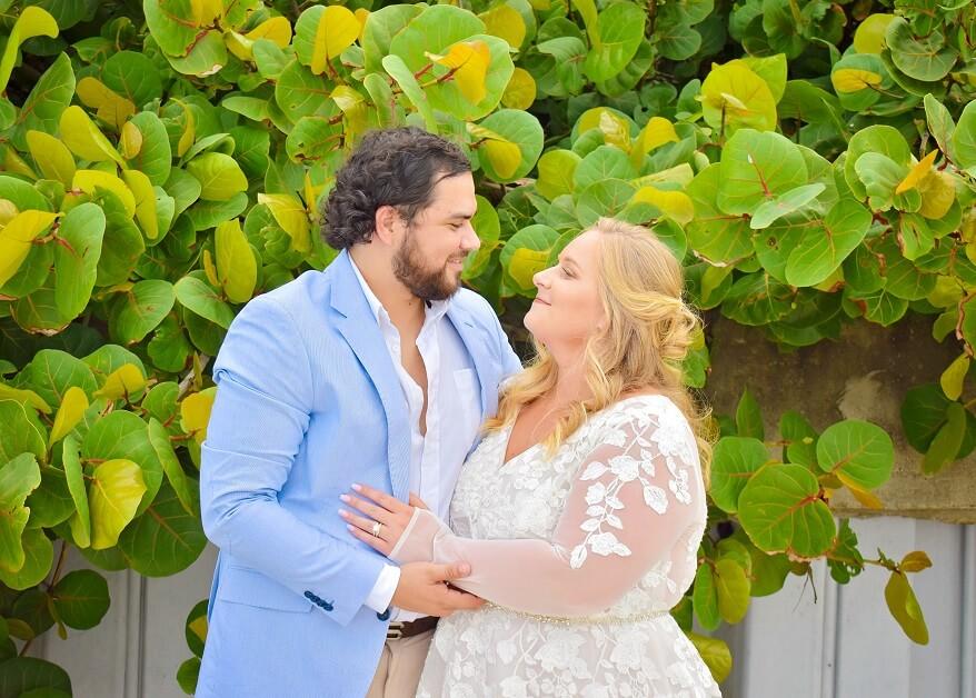 Couple by sea grapes married on Daytona Beach