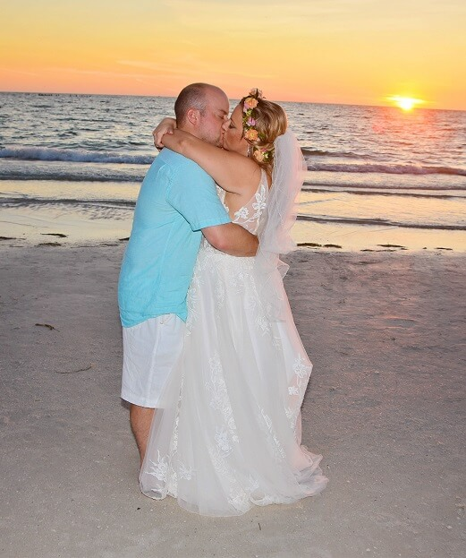 Sunset Beach Clearwater couple kisses after wedding