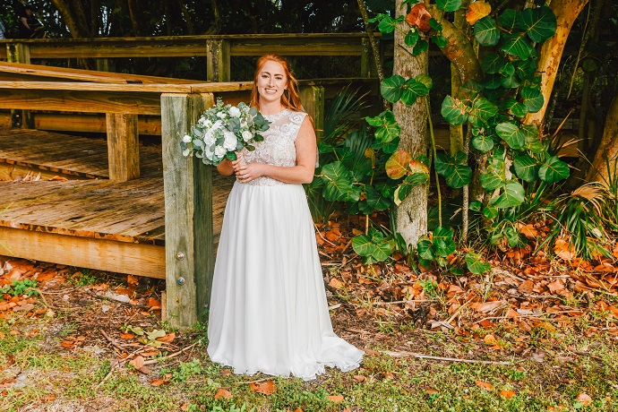 Bride Smiling before wedding Cocoa Beach trees