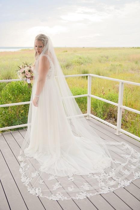 Bride poses before wedding in Siesta Key on the beach