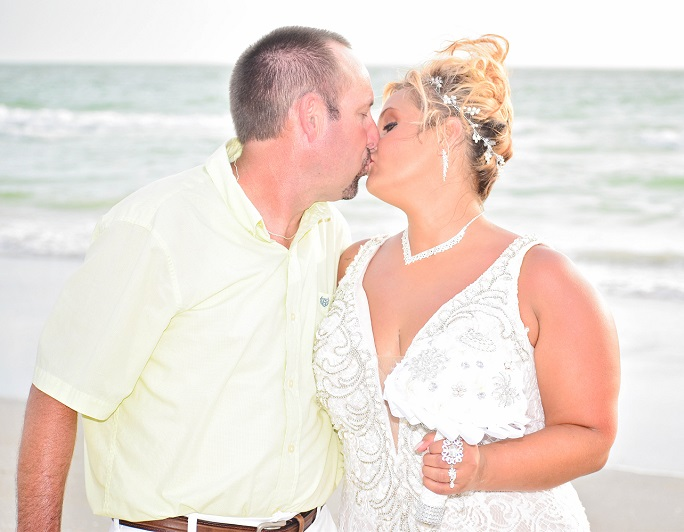 Couple kissing by the sea in Clearwater Beach, FL