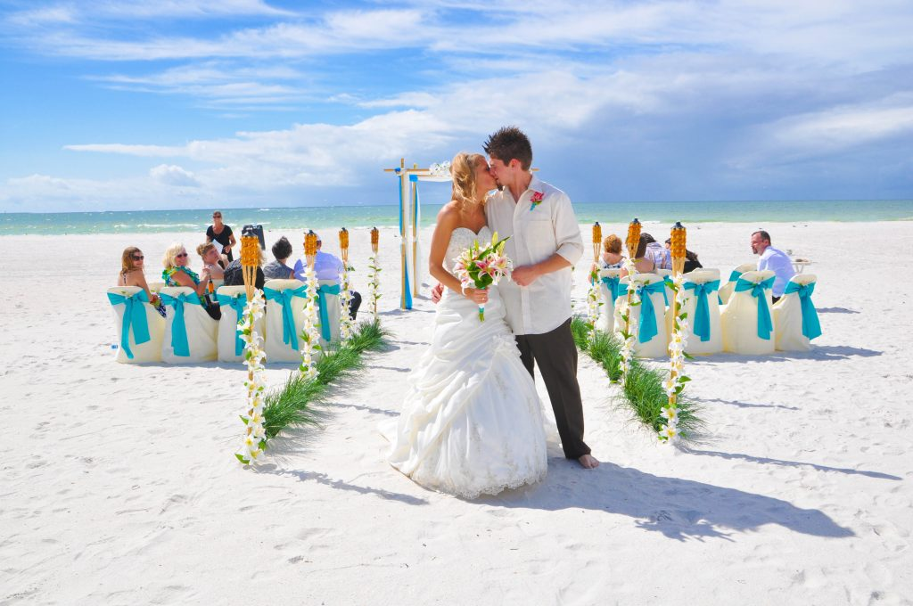 Clearwater couple kissing at beach wedding
