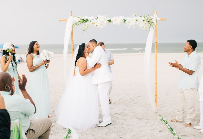 Couple kisses at Jacksonville Beach Wedding