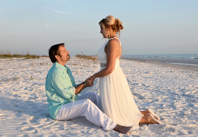 Bride and Groom hold hands on Siesta Key Sand