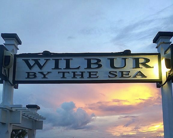 Wilbur By The Sea sign with sunset