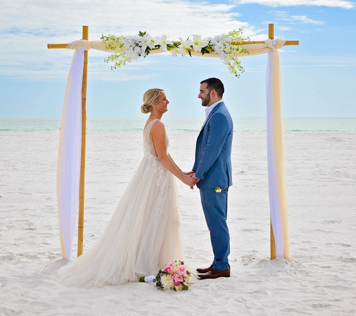 Bride and Groom married under bamboo wedding arch Siesta Key Beach