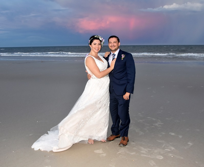 Sunset on St Augustine Beach with married couple posing