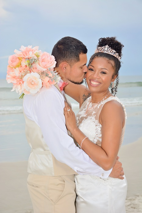 Couple just married hugging on the beach in Daytona