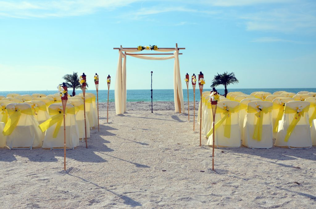 Yellow wedding material on bamboo wedding arch on Clearwater Beach
