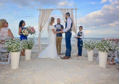 Bride and groom say vows holding hand on Wilbur Beach, Daytona FL
