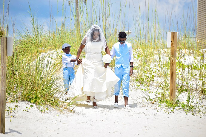 Bride walks with ring boys Fort Myers Beach
