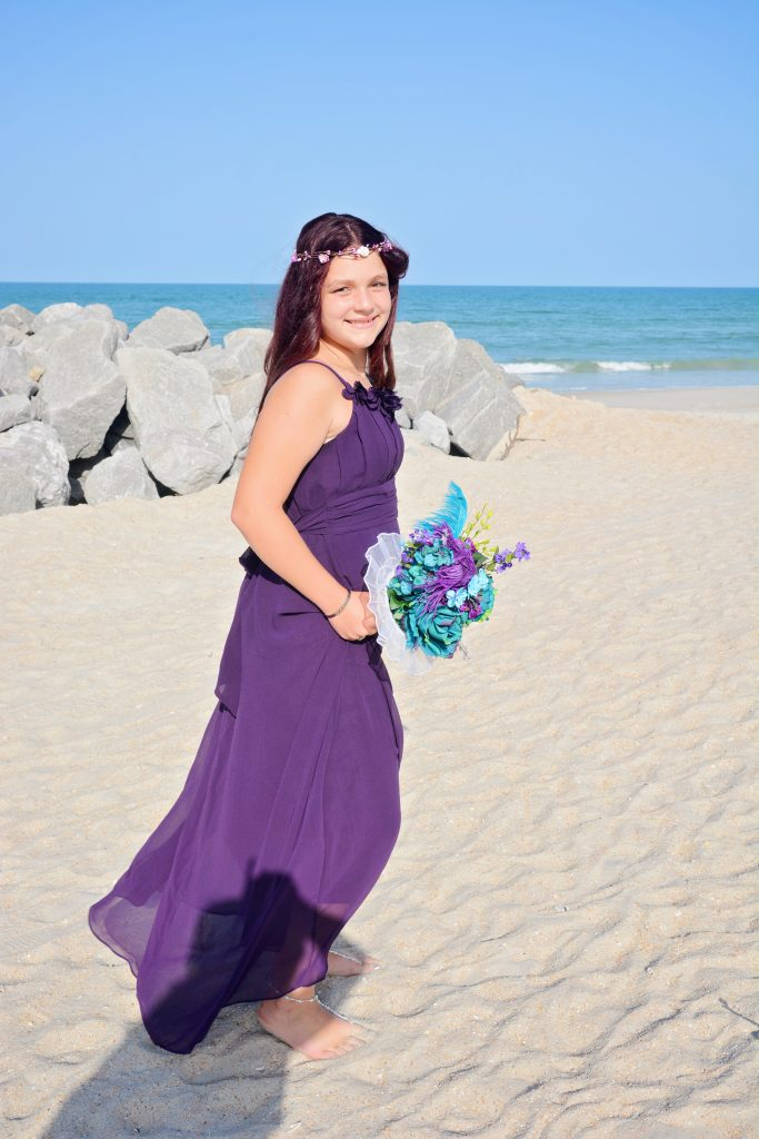Bridesmaid in purple dress on Florida beach