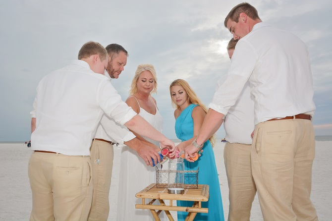 Family in Clearwater Beach takes part in sand ceremony at beach wedding