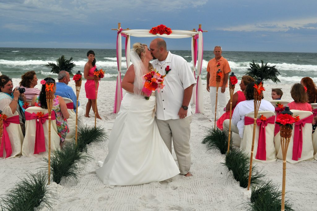 Couple kisses at Daytona Beach Wedding