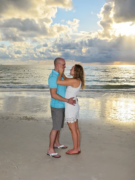 Couple elopes at sunset on Clearwater Beach FL