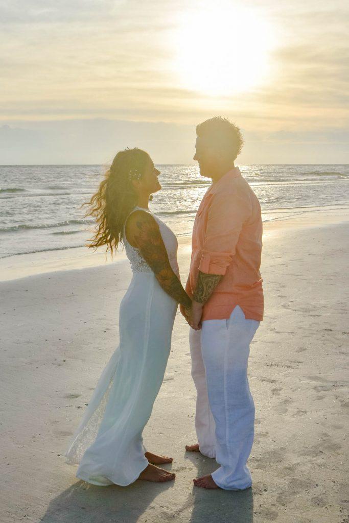 Lesbian beach wedding in Siesta Key at sunset