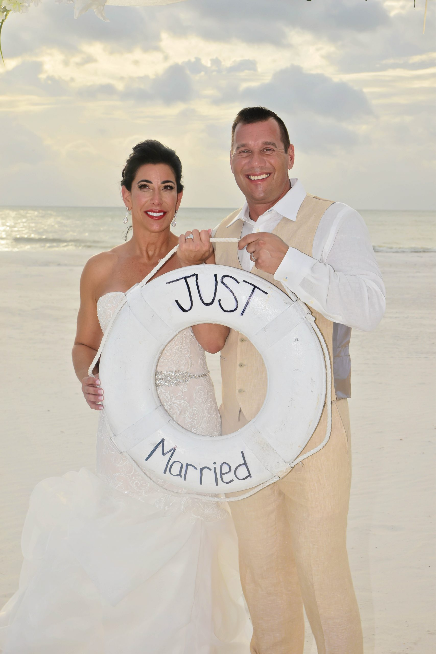 Clearwater beach just married couple poses with bouy
