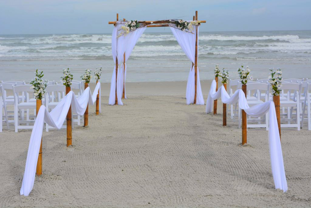 Natural branch and floral topper on wedding arch Daytona Beach