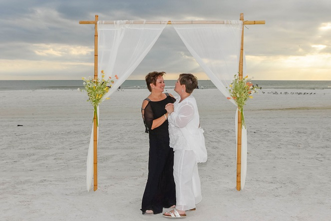 Same sex marriage couple after beach wedding Siesta Key