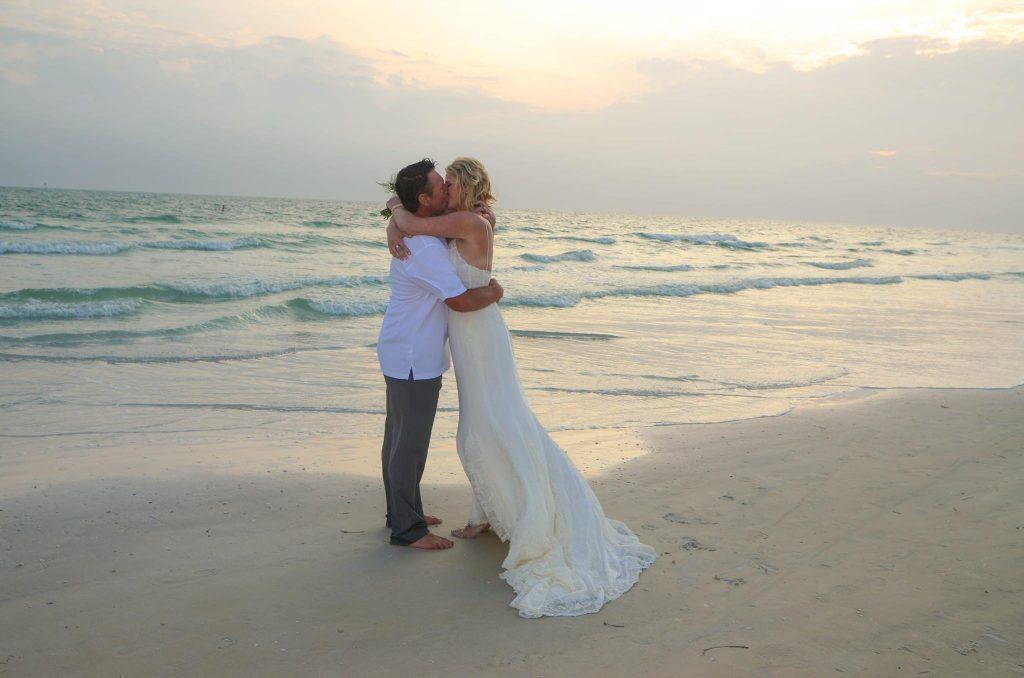 Kissing bride and groom on Siesta Key beach