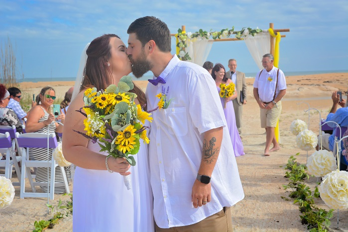 Wedding couple kisses in St. Augustine with sunflowers