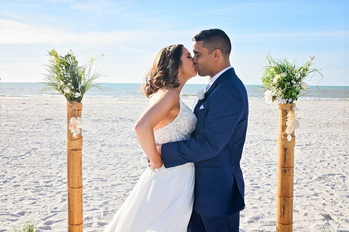 Clearwater Beach wedding couple kisses after vows
