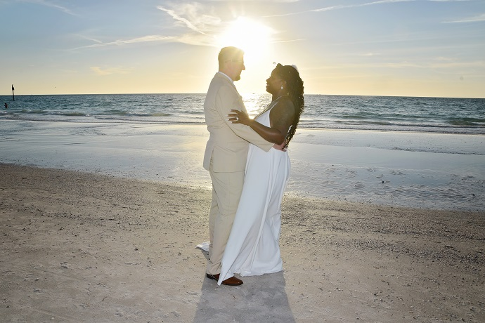 Wedding couple at sunset on Clearwater Beach