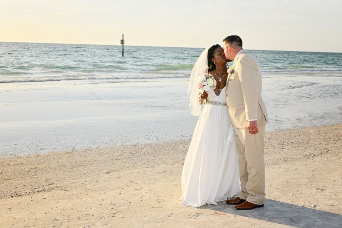Couple walks on Clearwater Beach after wedding