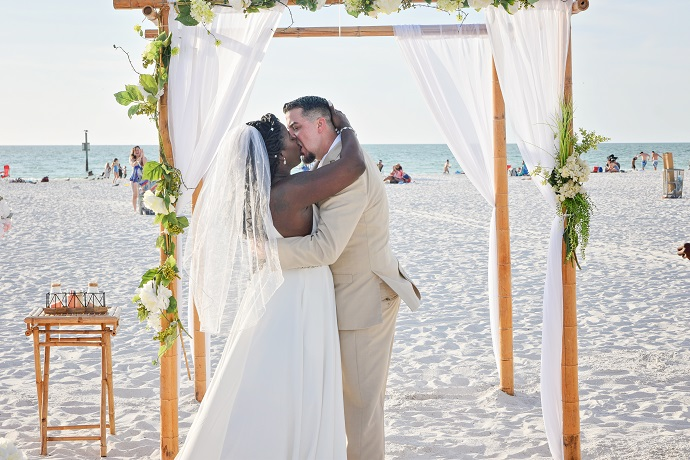 Kissing at Clearwater Beach Wedding