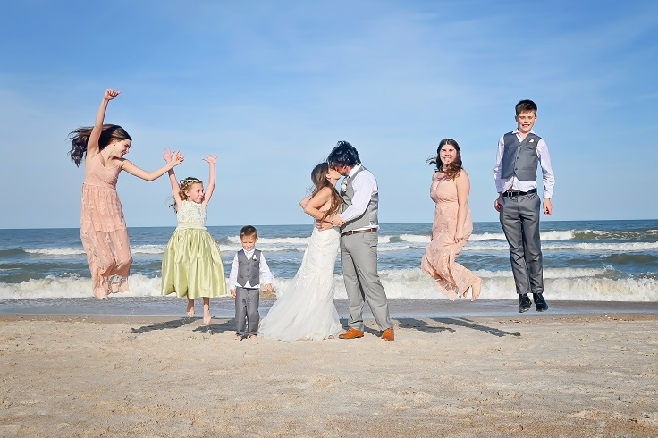 Bridal party jumping on St. Augustine beach