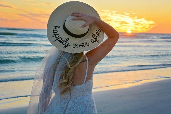 Bride in Hat at sunset in Siesta Key