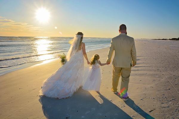 Beach Bride, Groom and Child at sunset on Gulf Beach