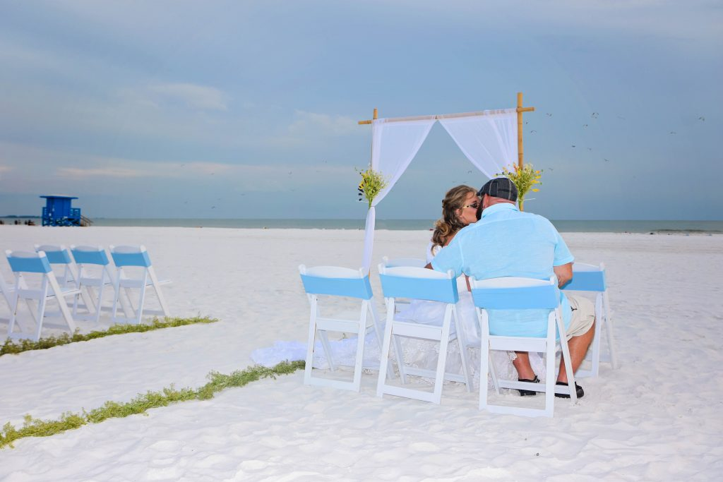 Blue chairbands on beach wedding package